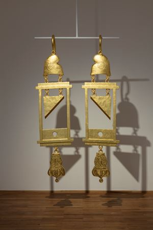 A Dramatically Enlarged Set of Golden Guillotine Earrings Depicting the Severed Heads of Marie Antoinette and King Louis XVI by Simon Fujiwara contemporary artwork