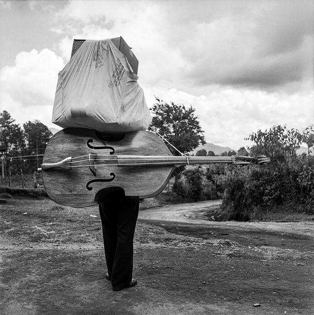 Bass and a Bundle, Santa Lucía Utatlán, Guatemala by Rosalind Fox Solomon contemporary artwork