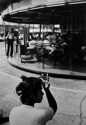 Woman and Carousel, Coney Island by Louis Draper contemporary artwork