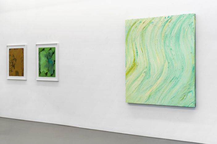 Installation view  Journey to the Mediterranean, Buchmann Galerie – left: BALTHASAR BURKHARD, Himmel (Sky), 2003, 125 x 158 cm / 49¼ x 62¼ in;  middle: BALTHASAR BURKHARD, Normandie, 1995, 90 x 130 cm / 35½ x 51¼ in;  right: DANIEL BUREN, Westwind - travail situé, 2010, Fabric, steel, fans, clips (fabric with blue and white stripes), 6-teilig, je 43,5 x 200 cm / 6-part, each 17¼ x 78¾ in