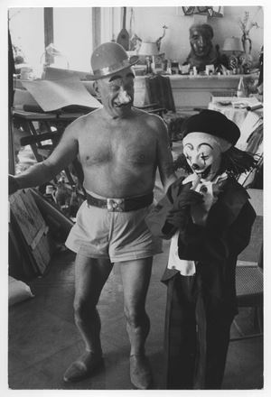 Pablo Picasso et son fils Claude déguisés en clown [Pablo Picasso and his son Claude disguised as clown] by David Douglas Duncan contemporary artwork