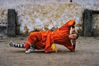 Young monk practicing Shaolin, one of the oldest styles of Kung Fu, Shaolin Monastery, Henan Province, China by Steve McCurry contemporary artwork photography