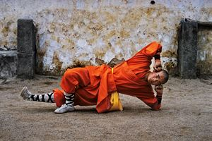 Young monk practicing Shaolin, one of the oldest styles of Kung Fu, Shaolin Monastery, Henan Province, China by Steve McCurry contemporary artwork