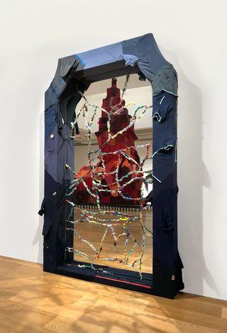 Yin Xiuzhen,Fake Gate No. 2 (2019). Steel, used clothes, mirror. 260 × 160 × 20 cm. © Yin Xiuzhen. Courtesy Pace Gallery.