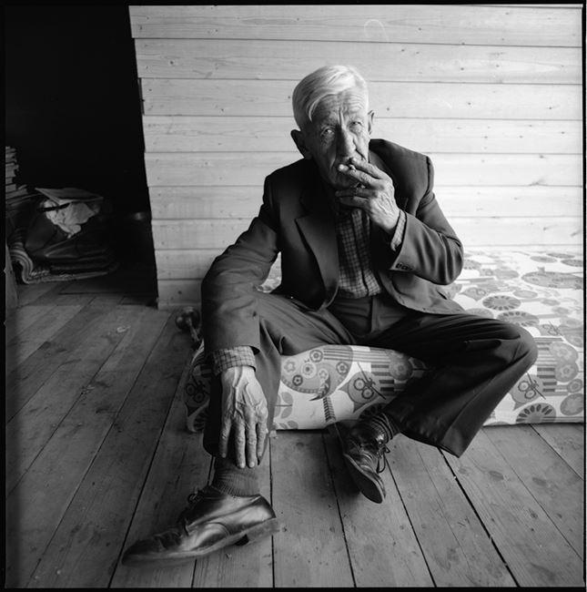 A man with cigaret, Vilnius by Antanas Sutkus contemporary artwork