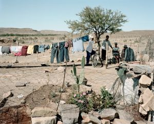 Willem Voster with friends, family, home and garden, Merweville, Western Cape, 2 March 2009 by David Goldblatt contemporary artwork
