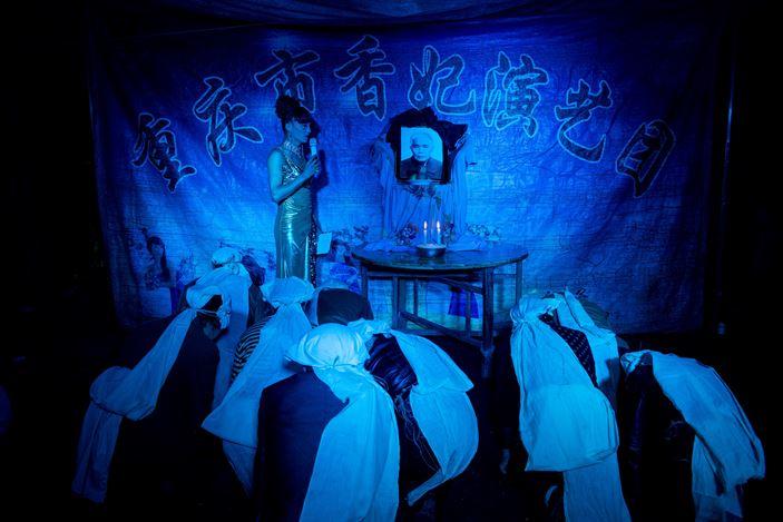 Tomoko Kikuchi, Funerals under Neon Light, (2014 - Ongoing). 28 Photographs, 1 Slide Projector. Courtesy of the Artist.