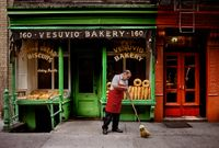 A man sweeps outside a bakery, New York, NY, USA by Steve McCurry contemporary artwork photography