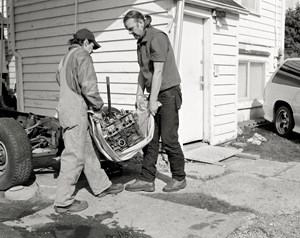 Men move an engine block by Jeff Wall contemporary artwork