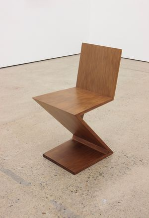 A Zig-Zag Chair designed by Gerrit Rietveld in 1934 and reproduced using 45,910 year-old swamp kauri wood in 2015 by Simon Starling contemporary artwork