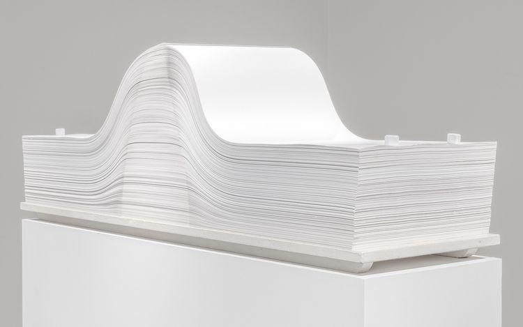 Enrico Castellani, Spartito (1969/2004). Sheets of paper and metal bolts on a wooden base. 42 x 35 x 120 cm. CourtesyLévy Gorvy.