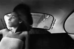 Ann Young in VW Bug, Manhattan by Chester Higgins contemporary artwork photography