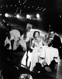 Suzy Parker and Robin Tattersall, Evening Dress by Grès, Moulin Rouge, Paris, August 1957 by Richard Avedon contemporary artwork photography