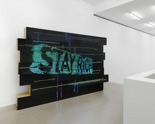 Birgit Brenner,Stay Rich(2021).LEDs on cardboard. 210 cm x 315 cm. Exhibition view: The Armory Show, New York (9-12 September 2021). CourtesyGalerie EIGEN + ART. Photo: Uwe Walter.