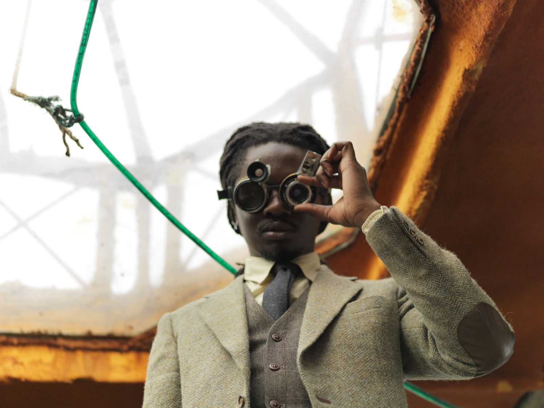Larry Achiampong and David Blandy, Finding Fanon 1, 2015. UHD digital video, 15 min, 22 sec. Exhibition view at EVA International – Ireland's Biennial 2016. Photo Miriam O'Connor. Courtesy the artists and EVA International.