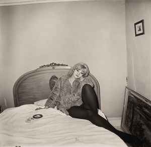 Girl in a coat lying on her bed, NYC by Diane Arbus contemporary artwork