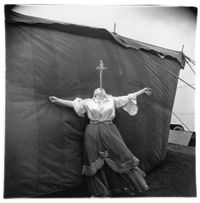 Albino sword swallower at a carnival by Diane Arbus contemporary artwork photography
