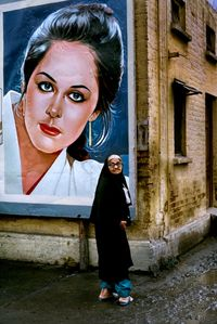 Woman outside the Rawalpindi Station along the Grand Trunk Road, Pakistan by Steve McCurry contemporary artwork photography