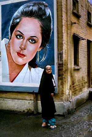 Woman outside the Rawalpindi Station along the Grand Trunk Road, Pakistan by Steve McCurry contemporary artwork