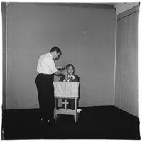 Photographer posing communion boy, N.Y.C. 1968 by Diane Arbus contemporary artwork photography