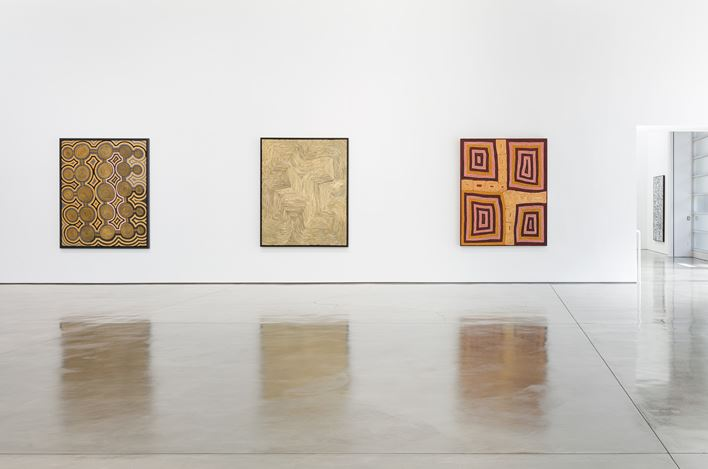 Exhibition view: Group Exhibition,Desert Painters of Australia Part II, Gagosian, Beverly Hills (26 July–6 September 2019).Artwork, left and right: © Ronnie Tjampitjinpa/Copyright Agency. Licensed by Artists Rights Society (ARS), New York, 2019; center: © Warlimpirrnga Tjapaltjarri/Copyright Agency. Licensed by Artists Rights Society (ARS), New York, 2019. Photo: Fredrik Nilsen.