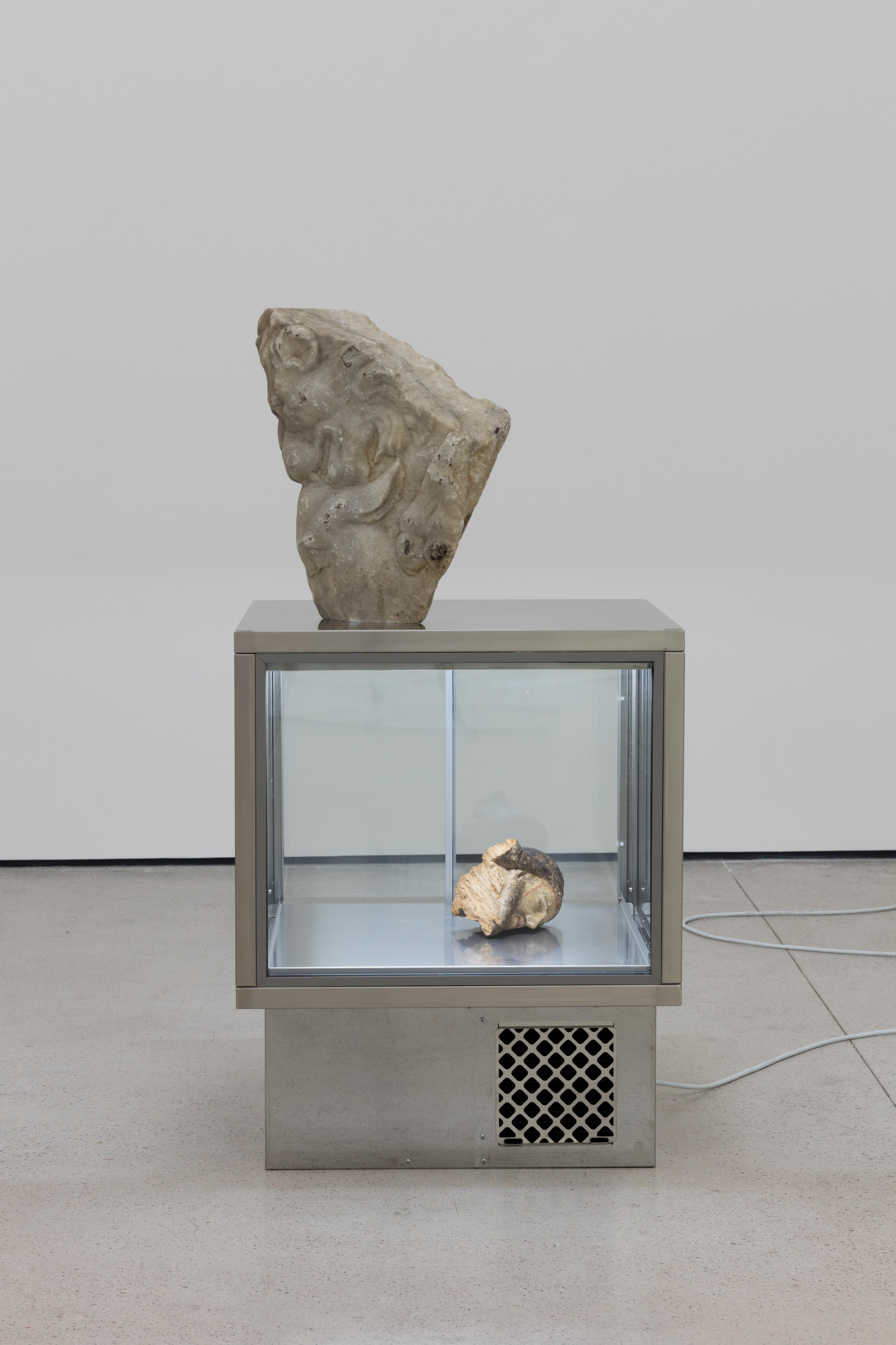 Image: Danh Vō, Lick Me, Lick Me, 2016. Refrigerator, wooden head of polychrome Jesus, 16th century and marble Roman sculptures, I-II century A.D. 126 x 64. 5 x 61 cm. Exhibition view, Danh Vō, White Cube Hong Kong. 7 September – 12 November 2016 . © Danh Vō. Photo © White Cube (Kitmin Lee).