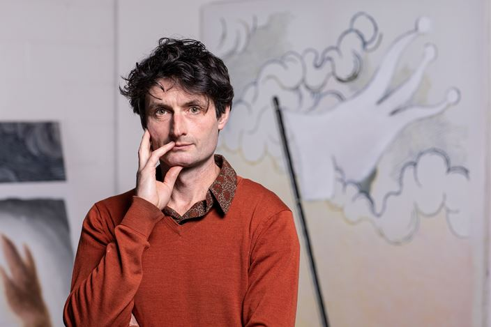 Benjamin Armstrong in the studio, in front of White Flag I.Photograph by Andrew Curtis,May 2020. Courtesy Tolarno Galleries.
