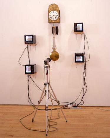 Nam June Paik, French Clock TV(1989).4 monitor sets (Panasonic), clock, video camera on tripod. 170 x 140 x 200 cm. CourtesyTang Contemporary Art, Hong Kong.