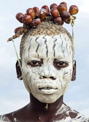 Kara Boy with Chalk Make up and Berry Adornment, Omo River, Ethiopia by Carol Beckwith & Angela Fisher contemporary artwork