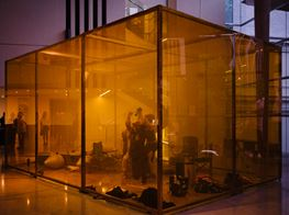 Alicia Frankovich Stages Performance in Wildfire-Orange Cube