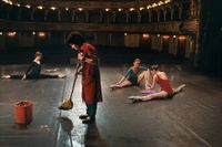 Man sweeps on stage while ballerinas stretch, National Ballet, Zagreb, Croatia by Steve McCurry contemporary artwork photography