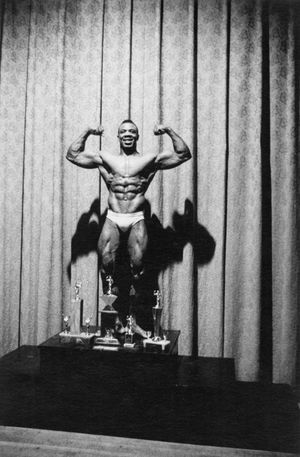 Kenneth Hall, the new Mr. New York City, at a physique contest, N.Y.C. 1959 by Diane Arbus contemporary artwork