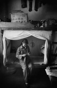 Worker in a Factory Dormitory, Kunming, China by Marc Riboud contemporary artwork photography, print