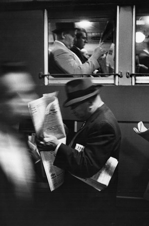 Commuters Reading Newspaper by Louis Stettner contemporary artwork