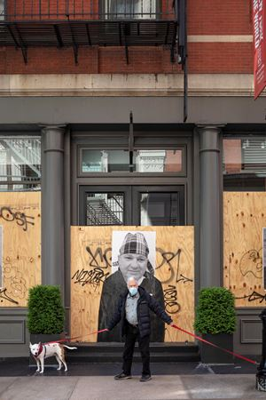 Man with Dogs, SoHo, Mercer Street, NYC, 12 May 2020 by Sean Hemmerle contemporary artwork