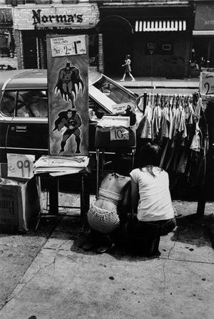 Two Girls Kneeling on Street with Batman, New York by Louis Draper contemporary artwork