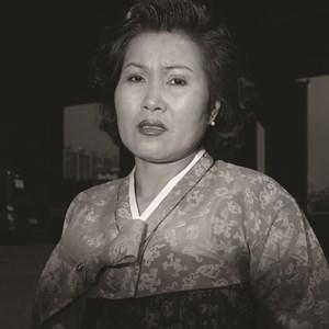 Ajumma wearing a jade green Korean traditional dress, March 27 by Hein-kuhn Oh contemporary artwork