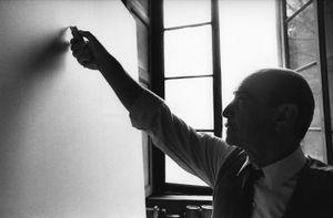 Lucio Fontana, Waiting, Milan (4) by Ugo Mulas contemporary artwork
