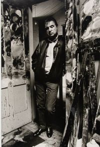 Francis Bacon standing in the doorway of his studio by Bruce Bernard contemporary artwork photography