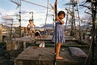 'Children playing on Walled City rooftop', Hong Kong by Greg Girard contemporary artwork photography, print