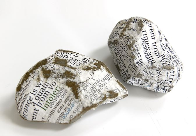 Stefana McClure, Protest Stones (Brexit) (2016). Paper-wrapped stones. Left 6 x 11 x 8 cm, right 9 x 12 x 9 cm. Courtesy Bartha Contemporary.