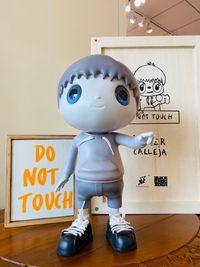 Do Not Touch by Javier Calleja contemporary artwork sculpture