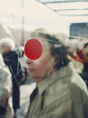 FRANCE. Sete. A red dot on the glass of a bus stop. by Christopher Anderson contemporary artwork
