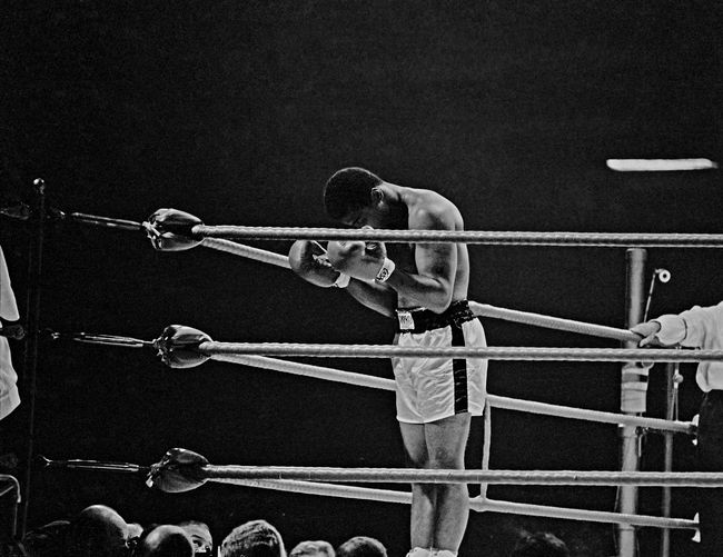 Ali praying in the ring before his title fight against Brian, London, 1966 by Thomas Hoepker contemporary artwork