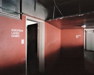 Apartheid-era bathroom signs, Ponte City (0976) by Mikhael Subotzky and Patrick Waterhouse contemporary artwork photography