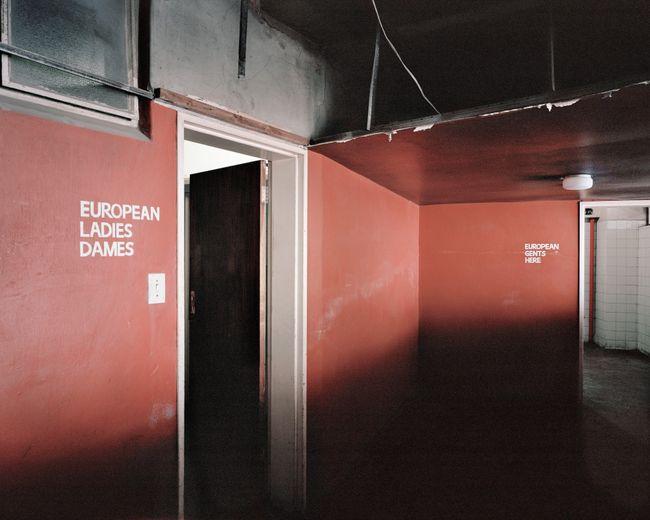 Apartheid-era bathroom signs, Ponte City (0976) by Mikhael Subotzky and Patrick Waterhouse contemporary artwork