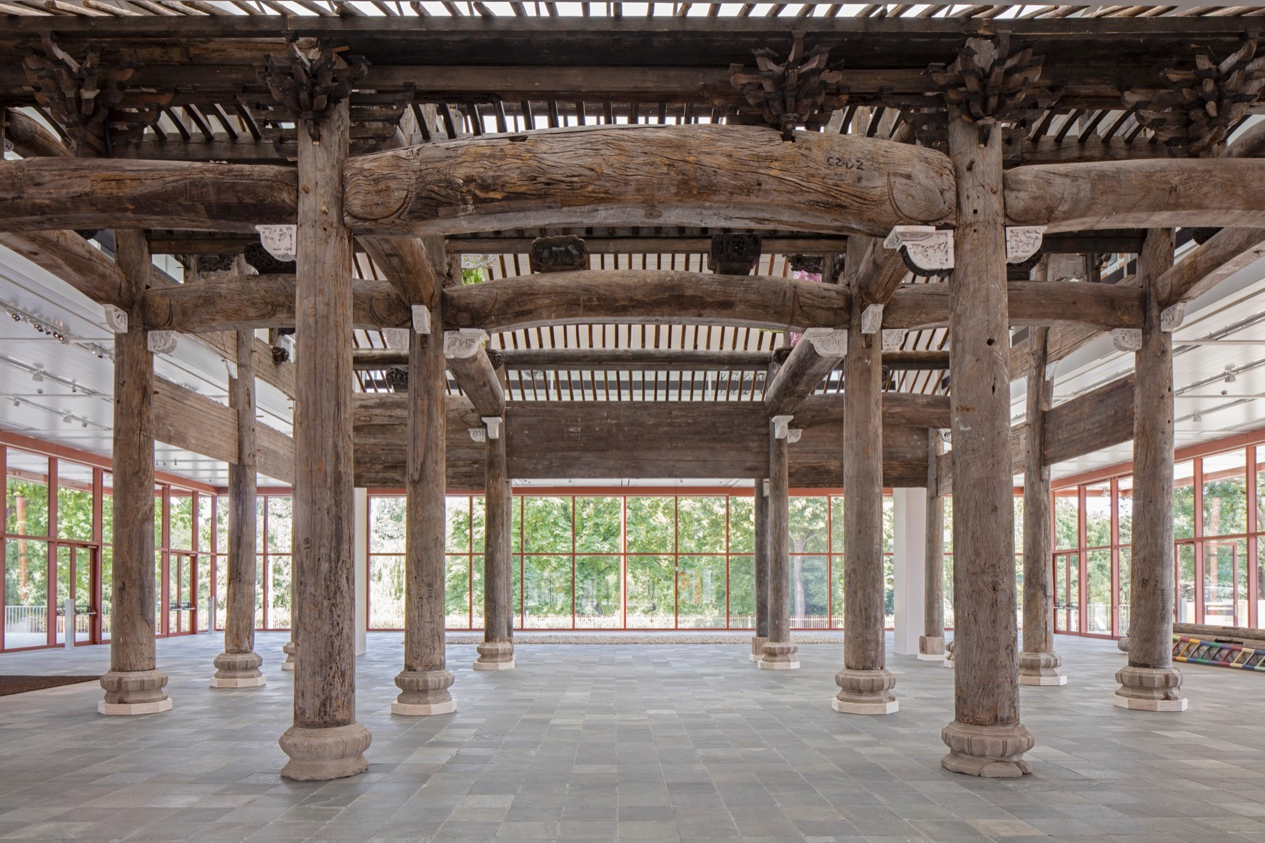 Image: Ai Weiwei, Wang Family Ancestral Hall, 2015. Over 1,000 pieces of various wooden building elements from late Ming-Dynasty (1368-1644) with original carvings and painted replacements, 1,364.7 x 1,451 x 939 cm. © Ai Weiwei Studio. Photo: © Belvedere, Vienna.