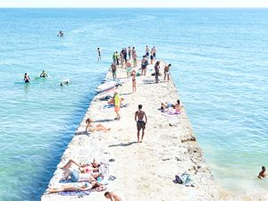 Carcavelos Pier Paddle by Massimo Vitali contemporary artwork