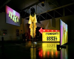 Mike Kelley,Extracurricular Activity Projective Reconstruction #27 (Gospel Rocket) (2004–2005). Mixed media with video projections. 228.6 × 508 × 563.9 cm. © Mike Kelley Foundation for the Arts. All rights reserved/Licensed by VAGA at Artists Rights Society (ARS), New York. Photo: Fredrik Nilsen.