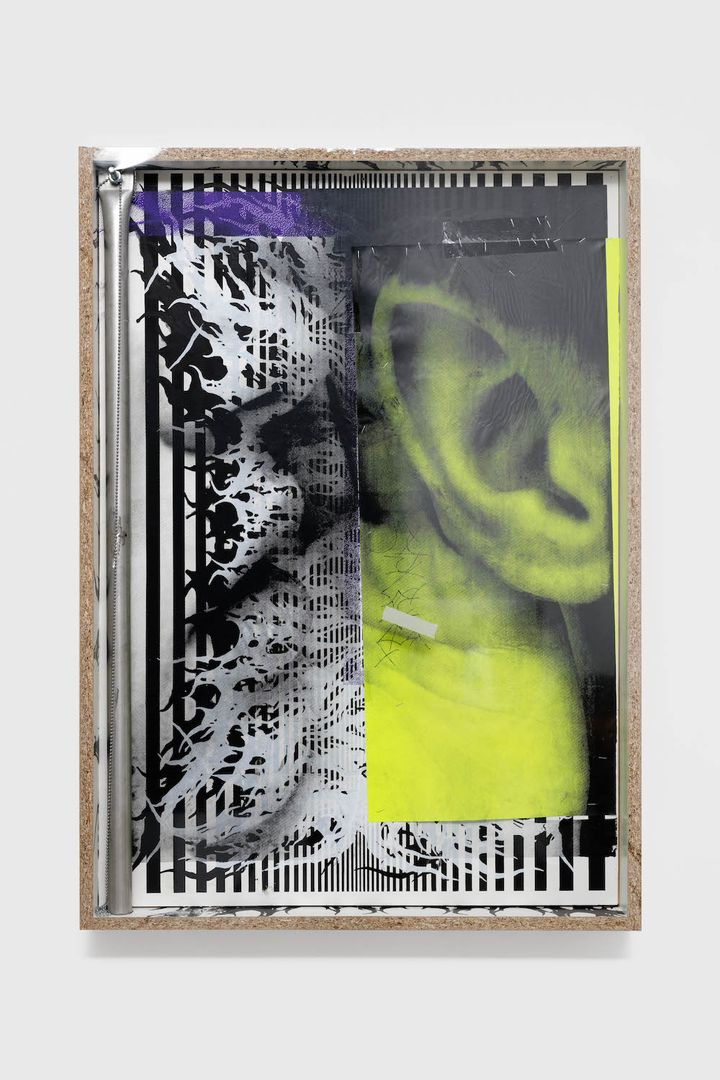 A black and green photograph of an ear is overlaid with collaged elements, including black and white striped paper.
